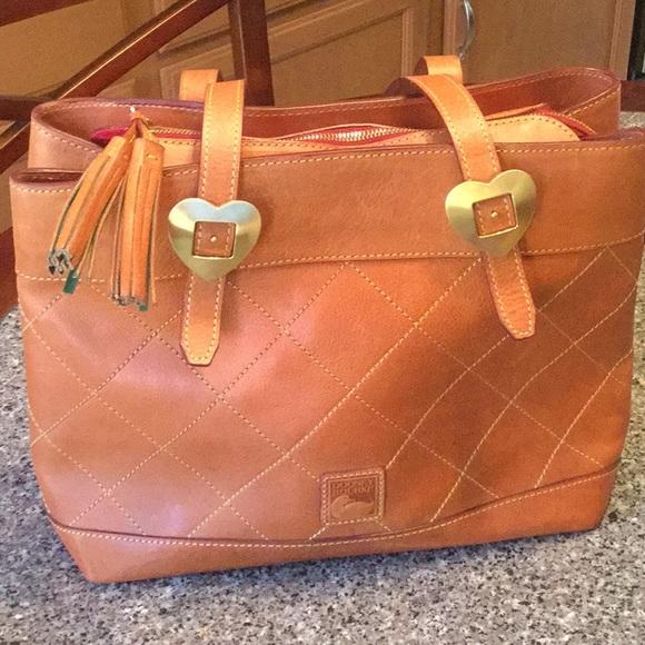 Dooney & Bourke Handbags - Dooney & Bourke Brown Bag With Red Lining